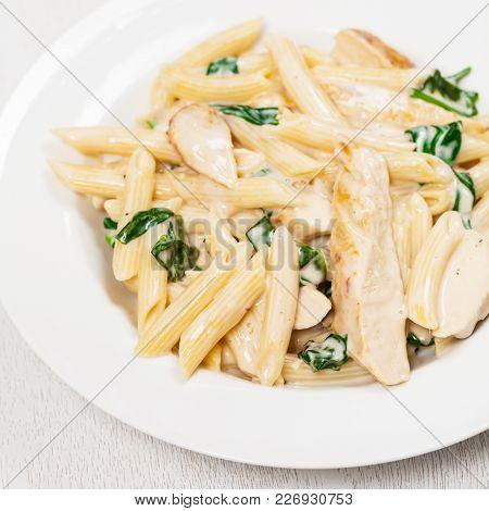 Spinach Chicken Alfredo Parmesan Pasta. Selective Focus.