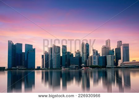 Singapore Skyline Business District And Cityscape At Colorful Sunset Sky Twilight In Singapore City,