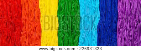 Colorful Embroidery Cotton Floss Background. Selective Focus.