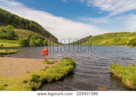 View Over Llyn Geirionydd With A Lifebuoy In The Foreground - Near Llanwrst, Conwy, Wales, Uk