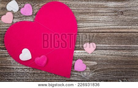 Valentines Day Background Card With Fabric Hearts Over Wooden Background. Selective Focus.
