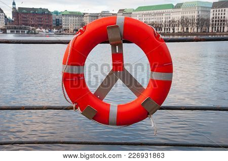 Lifebuoy An The Edge Of A Lake In The City