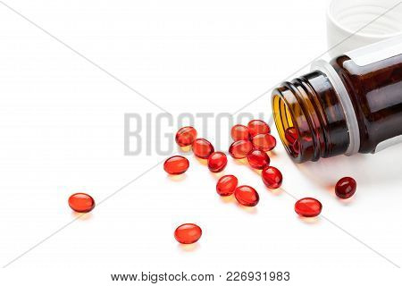 Closeup Shot Of Red Capsules. Isolated On White Background.