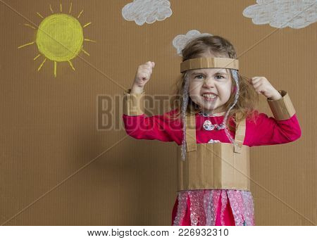 Portrait Of A Playful Child With A Cardboard Suit. Vintage Style