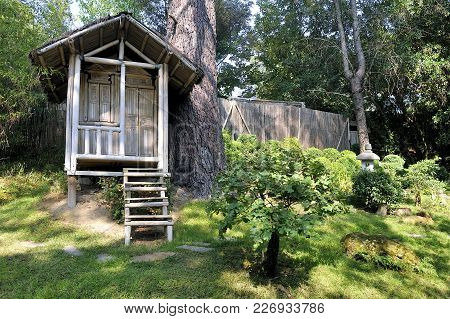 Japanese Garden With A Bamboo Hut On A Sloping Land