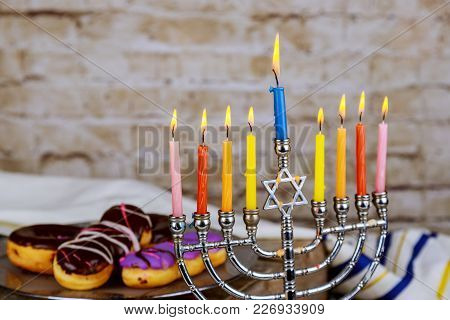 Hanukkah Flatlay: Hanukkah Candies Sufganiot , Menorah, Multicolor Candles And Donuts
