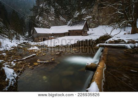 Old Wooden Water Mill At National Nature Reserve Kvacianska Dolina In Slovakia In Winter.  It Has Be