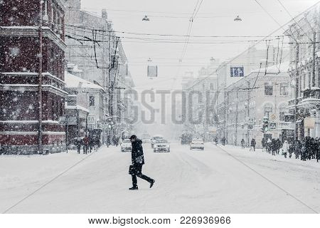 Winter Has Come. Snowy Beautiful Busy City With Cars And Passer By, Heavy Snowfall. Paralysed City D