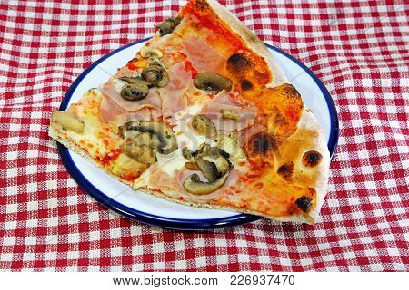 Slice Of Pizza Garnished With A Lot Of Ham Mushrooms Mozzarella And Fresh Tomato At The Italian Rest