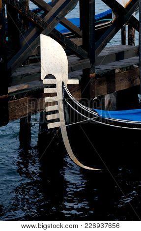Bow Of Gondola Symbol Of Venice Island In Italy