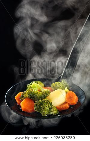 Steamed Broccoli, Potatoes And Carrots With Steam.
