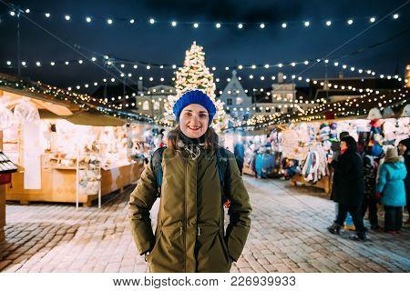 Tallinn, Estonia. Young Beautiful Pretty Caucasian Girl Woman Dressed In Green Jacket And Blue Hat E