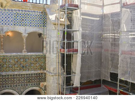 Scaffolding Near A Building With A Historical Tile Azulejos Renovation