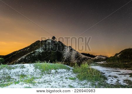 Starry Night Sky Over The High Chalk Hill. Night Natural Landscape. Natural Archaeological Monument