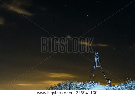 Dslr Camera On A Tripod Mounted On A Hill For Shooting Night Views