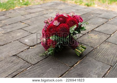 Red Bridal Bouquet From Dahlias. Wedding Floristic