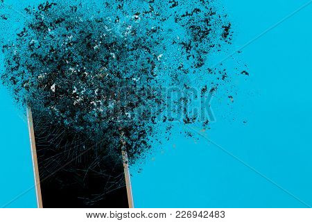 Smartphone Explosion On Blue Background. Edit By Using Explosion Effect.