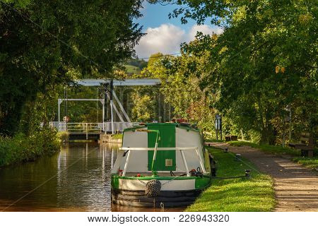 The Monmouthshire & Brecon Canal With A Boat And The Lift Bridge, Seen In Talybont On Usk, Powys, Wa