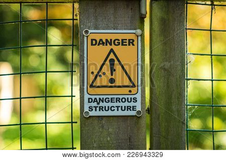 Sign: Dangerous Structure, Seen In Oare Near Faversham, Kent, England, Uk