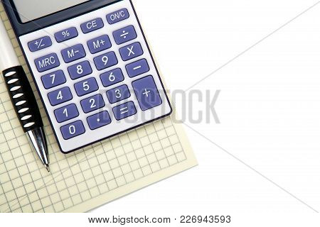 One Big Calculator With Yellow Checkbook And Stationery On A White Table Closeup