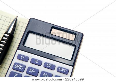 One Big Calculator And A Pen On A White Table Closeup