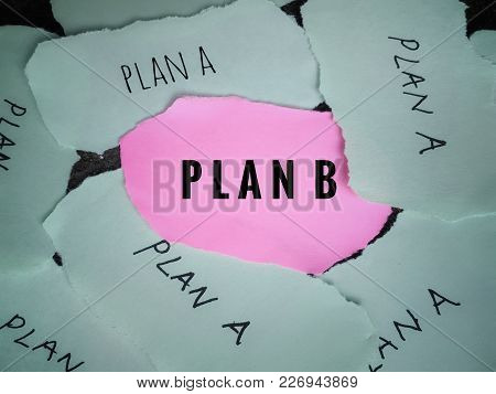 Planning Concept. Plan A And Plan B Written On Ripped Papers. Plan B Written On Pink Paper Which Is