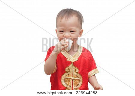 Little Asian 2 Years Old Toddler In Red Chinese Suit Eating Chinese Steamed Longevity Buns (shoutao
