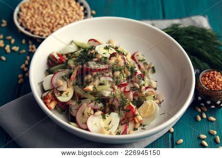 Salad With Vegetables And Eggs On The Colorful Blue Background. Close Up. European Cuisine. Radish,