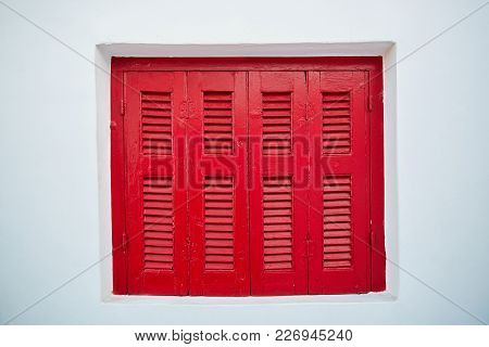 Red Closed Wooden Window At White Wall