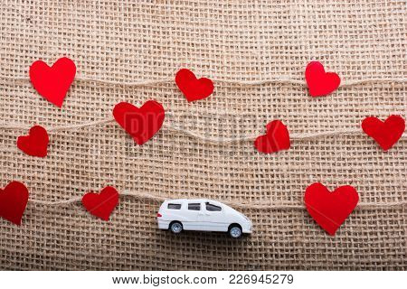 Love Concept With Car And Paper Heart On Linen Threads