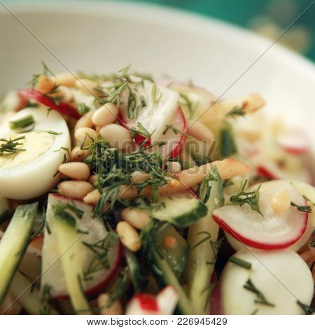 Quail Eggs Salad In The White Bowl. Healthy Lunch. European Cuisine. Close Up. Radish, Cucumber, Qua