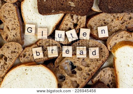Gluten Bread Text. Sliced Bread On The Top Of Table, Gluten Free Concept. Homemade Gluten Free Bread