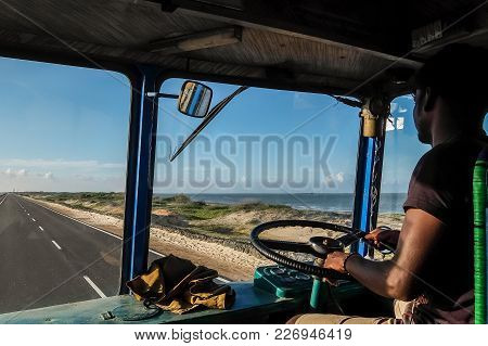 Rameshwaram, India - December, 21st, 2016. Indian Truck Driver Inside The Cockpit