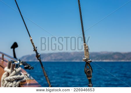 Ship Metallic Rope With Nuts And Bolts On Blurred Blue Sea Horizon