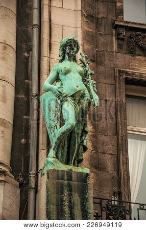 Close-up Of Female Statue In A Building On A Cloudy Day In Antwerp. Port And Multicultural Metropoli