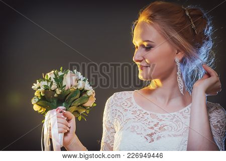 Beautiful Bride In A White Dress In The Studio During A Photoshoot With Nice Light