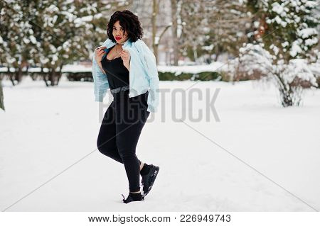 Stylish African American Plus Size Model With Mobile Phone At Hand  At Winter Snowy Day.