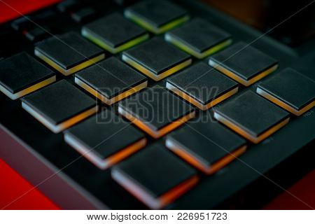 Black Modern Musical Instrument, Sampler On An Intense Red Background
