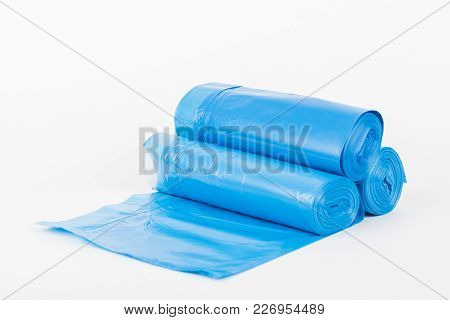 Rolls Of Disposable Trash Bags Isolated On White Background.