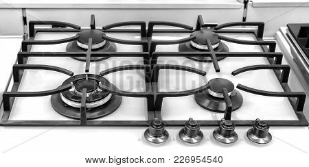 A Fragment Of The Surface Of The Gas Stove: Burner And Stand. Presents Closeup.