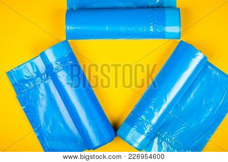 New Blue Garbage Bags On A Yellow Background