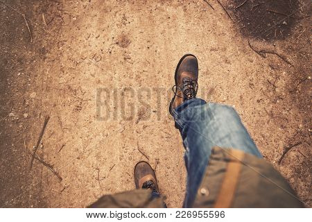 Legs And Feet Hiking On Trail Outdoos In Nature With Copy Space