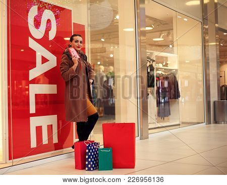 Young Shopaholic Spending More Money For Shopping At Shopping Mall. Lifestyle Concept