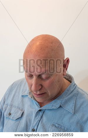 Older Man Looking Down, Bald, Alopecia, Chemotherapy, Cancer, Isolated On White, Vertical Aspect