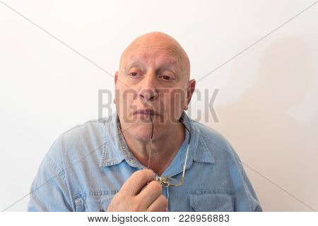 Older Man With Glasses Looking Thoughtful, Bald, Alopecia, Chemotherapy, Cancer, Isolated On White,