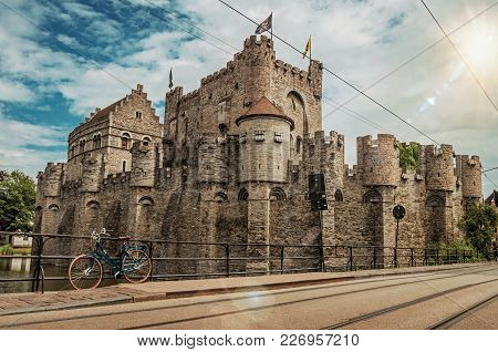 Bridge And Bike In Front Of Gravensteen Castle In Ghent. In Addition To Intense Cultural Life, The C