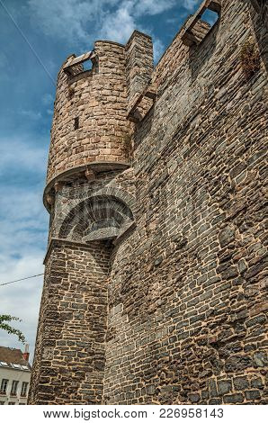 Close-up Of Stone Wall And Watch-tower Of The Gravensteen Castle In Ghent. In Addition To Intense Cu