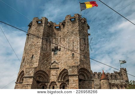 Close-up Of Stone Watch-tower And Flag In The Gravensteen Castle At Ghent. In Addition To Intense Cu