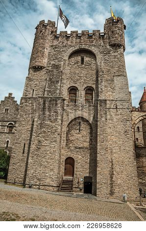 Stone Watch-tower, Door And Flags Inside The Gravensteen Castle At Ghent. In Addition To Intense Cul