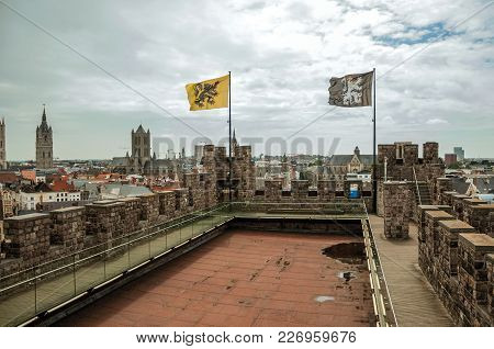 Gravensteen Castle Roof And Balustrade Overlooking Ghent Buildings. In Addition To Intense Cultural